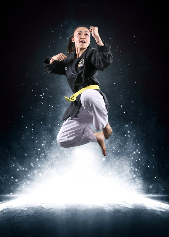 woman jumping in the air performing a martial arts trick