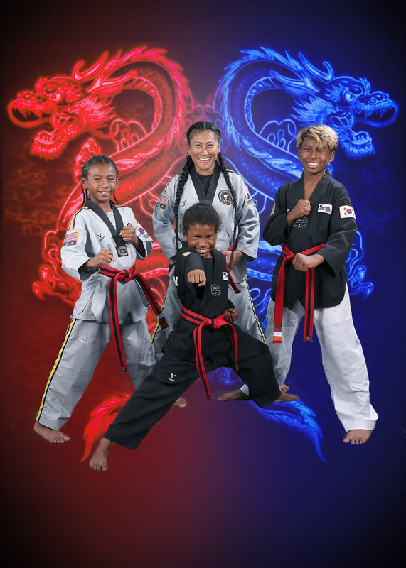 a family of four taking their taekwondo fighting stance with a red and blue dragon in the backgorund