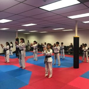 taekwondo class performing breathing exercises